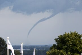 A waterspout touches down in the English Channel off the English coast on June 28, 2014.