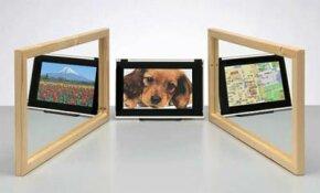 """一个尖锐的三维观察LCD面板。根据您查看它的方向,您可以看到三种不同的图像中的一个。查看更多HDTV图片。""""border="""
