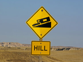 A road sign warns of a steep downhill section ahead. See more truck pictures.