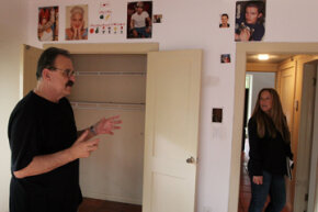 Real estate agent Shellie Young (right) shows a short sale home to David Sandlin in Miami.