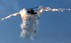 A Cobra attack helicopter releases a flare salvo in training exercises. Flares generate extreme heat away from the aircraft to divert Sidewinders and other heat-seeking missiles.