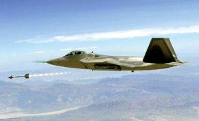An F-22 Raptor fighter jet fires a sidewinder.
