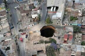 Aerial view of the huge hole in Guatemala City after the sewage system collapsed. If you look at the surrounding buildings, you can see how big that scary sinkhole is.
