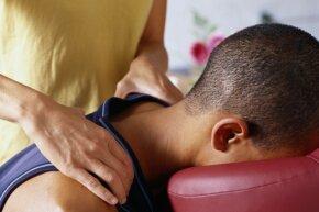 person getting a shoulder massage