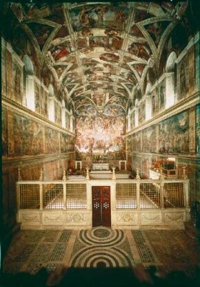 View of the Sistine Chapel with the elaborate paintings by Michelangelo.