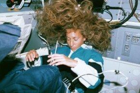 Astronaut Marsha Ivins sleeping aboard the shuttle Atlantis.