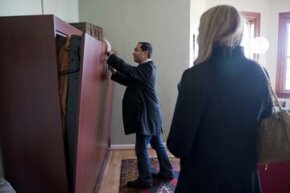 Rep.-elect Joaquin Castro, D-Texas, checks out a Murphy bed while apartment hunting on Capitol Hill.