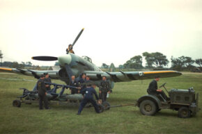 1940: Ground staff prepares to load a Hawker Typhoon with bombs.
