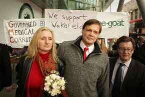 Surrounded by supporters, Dr. Andrew Wakefield (C) walks with his wife Carmel after speaking to reporters at the British General Medical Council in Jan. 2010. His medical license was revoked by that body later in the year.