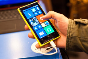 A man checks out the new Nokia Lumia 1020, which runs Windows Phone 8 and boasts a 41- megapixel camera, during London's Apps World exhibition in October 2013.