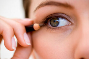 Next, you'll want to line your eyes, tracing as close to the lash line as possible.