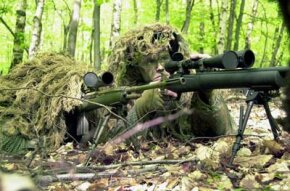 As part of a training exercise, the members of a sniper team man a 7.62mm Springfield Armory M21 Sniping rifle (left) and sights through the scope of a 7.62mm M24 Sniper rifle (right).