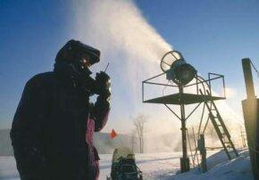 A snow-maker checks out an air snow gun at Wintergreen Resort in Virginia.