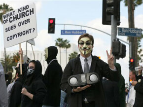 Groups like Anonymous use social networking sites to organize real world protests like this one against the Church of Scientology.