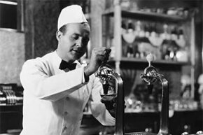 Back in the day, the smiling soda jerk did by hand what a fountain machine does -- but with more finesse.