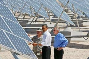 President Barack Obama, Senate Majority Leader Harry Reid of Nevada, and Col. Howard Belote, checked out the solar panels at Nellis Air Force Base in Nevada in May of 2009.