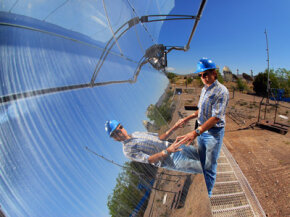 A parabolic trough solar collector system can warm tubes of oil to tremendous temperatures.