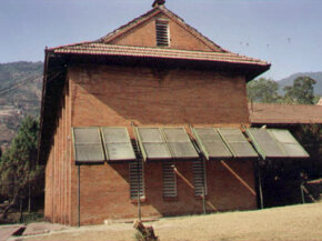 This school in Nepal uses solar water heater collector panels.