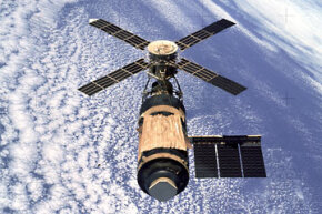 Skylab 1 in orbit after its repairs -- note the gold sunshade.