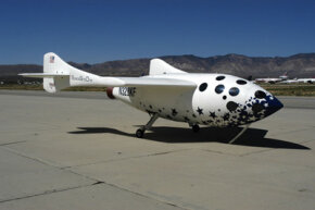 SpaceShipOne sits on the ramp on its landing gear.