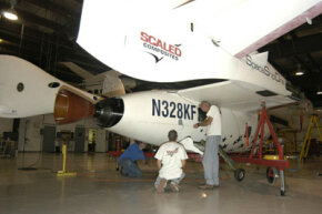 SpaceShipOne undergoes preflight inspection before its historic June space flight.