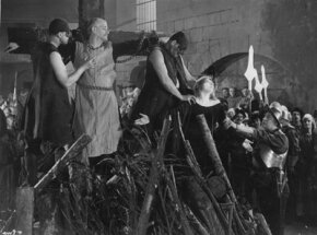 "Circa 1933: British actor Matheson Lang is chained to a cross during the Spanish Inquisition in a scene from the film ""The Wandering Jew."""