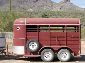 This horse trailer boasts a spare tire mount rack.