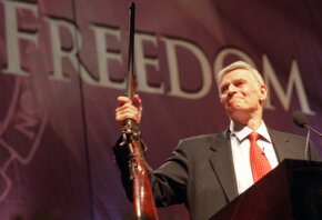 National Rifle Association president Charlton Heston at the special interest group's 2002 convention.