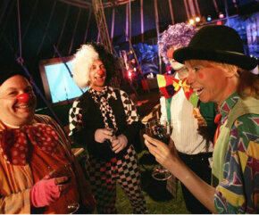 British clowns in full costume enjoy a drink as they gather for a speed-dating event at a circus in northern London.