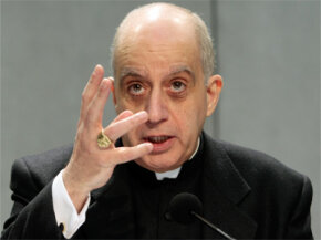 "Monsignor Rino Fisichella, who heads the Pontifical Academy for Life, gestures during a press conference at the Vatican on Feb. 17, 2009. The Vatican is warning of the ""relentless'' spread of a eugenics mentality with the advance of genetic testing."