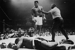 A gloating Muhammad Ali stands over Sonny Liston who was KO'd in the first round. Or did Liston take a dive?