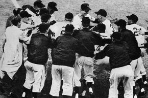 Bobby Thomson (center top) is mobbed by happy teammates after he hit the 'shot heard 'round the world' home run which won the game and the National League pennant for the New York Giants over the Brooklyn Dodgers  in 1951.