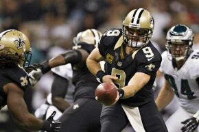 Drew Brees (No. 9) of the New Orleans Saints makes a hand-off against the Philadelphia Eagles in 2012.  Brees has said that the only questions he gets asked these days are about the bounty scandal.