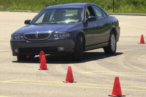 A test vehicle with its electronic stability control turned off slides over cones during a test in Auburn Hills, Mich., on July 16, 2003.