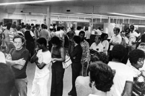 Unemployed autoworkers queuing at an unemployment office in Detroit, Michigan in 1980. The end of 1970s stagflation led to a significant U.S. recession.