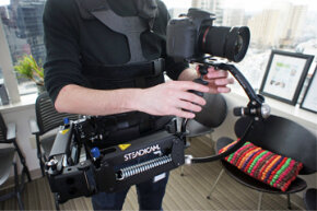 The Steadicam Merlin 2, pictured here at the HowStuffWorks office, is one of the next-generation, smaller camera stabilizer systems available to pros and amateurs.