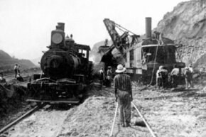 An American steam shovel delivering coal to a steam engine