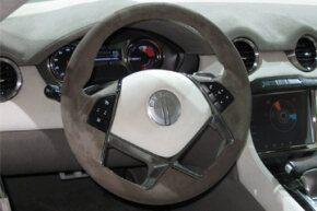 Note the electronic controls on this Fisker Karma S steering wheel. See more car safety pictures.