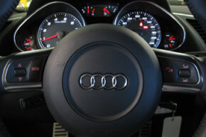 The Audi R8 has its fair share of steering wheel controls, too.