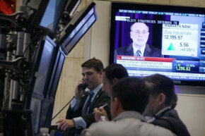 Traders work the floor of the New York Stock Exchange on June 22, 2011. See more investing pictures.