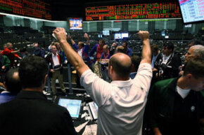 A trader at the Chicago Board of Trade watches as the Dow Jones Industrial Average, S&P 500 and NASDAQ Composite Index all fall upon news of soaring gas prices in July 2008.