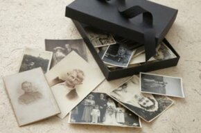 If you plan on looking at loose photos and handling them often, it's best to put them in a protective sleeve.