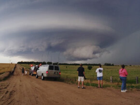 Meteorology students monitor an isolated supercell thunderstorm in Kansas on June 5, 2004.