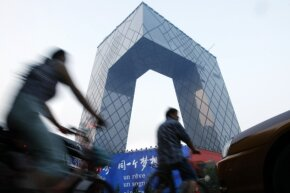 Shot of CCTV (China Central Television) building during construction in 2008. Principal architects Rem Koolhaas and Ole Scheeren designed the funky building.