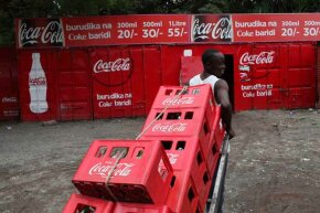 A Coca-Cola salesman in Nairobi, Kenya gets to work. Coke sales in Africa measure political stability.