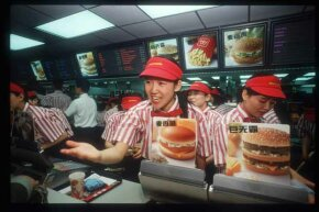 A worker takes an order from a customer in China's first McDonald's restaurant, back in 1992. According to the 'Big Mac Index,' global currency values can be measured by looking at the price of a Big Mac in various countries.