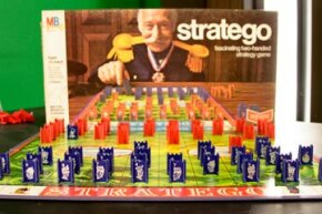 The full Stratego board from a vintage 1970 set, with foil-stamped game pieces.