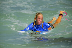 A shark's bite was strong enough to take Bethany Hamilton's arm while she was surfing at age 13. Hamilton (shown here in 2005) continued to surf competitively after recovering from her attack. See pictures of sharks.