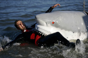 """Tory Belleci, of Discovery Channel's """"MythBusters,"""" tests the strength of a (mechanical) shark's bite the hard way."""