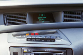Some auto computers, such as this one in a 1993 Lincoln Mark VIII, can tell you if you need more coolant.